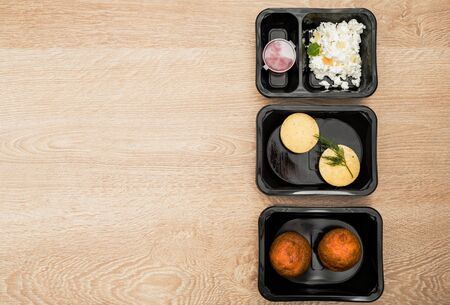 Healthy food delivery. Take away food for diet. Fitness nutrition, balanced proteins, fats and carbohydrates in plastic boxes. Top view, flat lay.