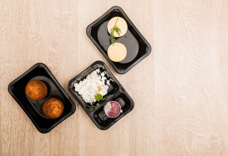 Healthy food delivery. Take away food for diet in plastic boxes. Top view, flat lay.