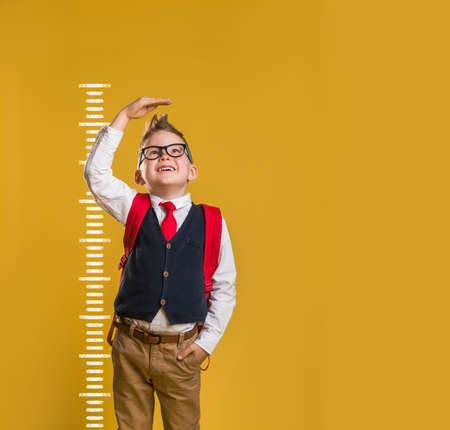 Full length body size view photo of kid impressed raise arm measurement unbelievable unexpected news open mouth anxious trendy fashionable clothing isolated on pastel background