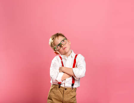 Portrait of kid businessman thinking. Success, creative and innovation concept