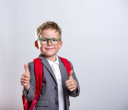 Portrait of child businessman with thumbs up. Success, creative and innovation business concept