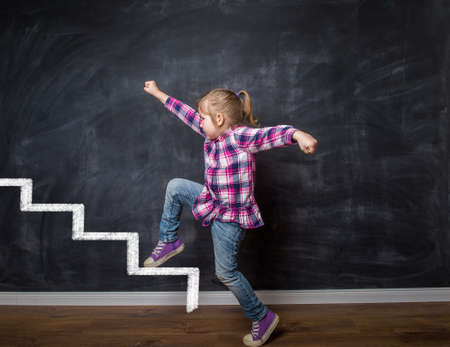 Little kid girl walking on top of the leader. Leader concept