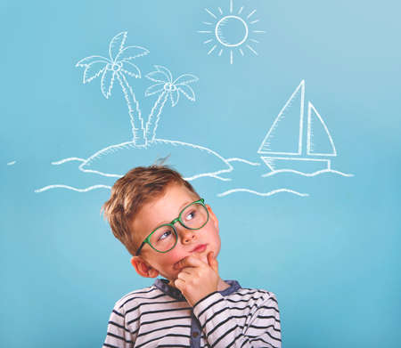 want to travel. kid dreams abut trip. child thinking Reklamní fotografie