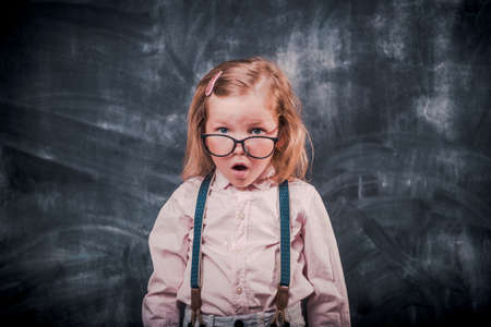 Funny little kid in glasses surprised. close up photo. back to school. genius. New generation Reklamní fotografie