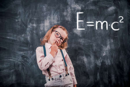 Funny little kid in glasses surprised. close up photo. back to school. genius. New generation. Math