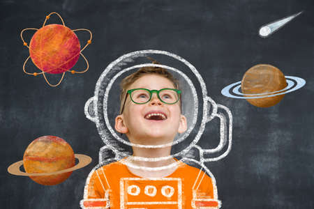 Child daydreams. Kid playing to be astronaut. Education. Little boy in glasses dreams to be a pilot Reklamní fotografie