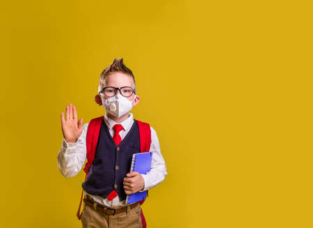 Back to school. Little schoolboy in face mask during corona virus and flu outbreak. llness protection for kids. Mask for coronavirus prevention. School kid coughing. Little boy breathes through mask. Reklamní fotografie