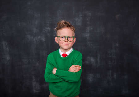 Little businessman looking confident and calm. Back to school. Thinking kid boy in glasses and uniform. Back to school. Reklamní fotografie