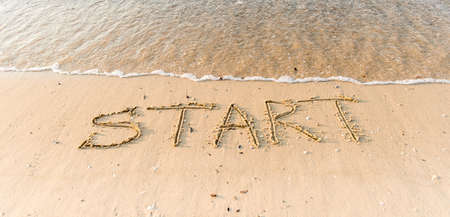 Word start written in beach sand. Motivation concept for beginning, doing and starting. Leader. Innovation. Start up