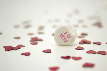 White message heart saying  I love you  with red sprinkle hearts