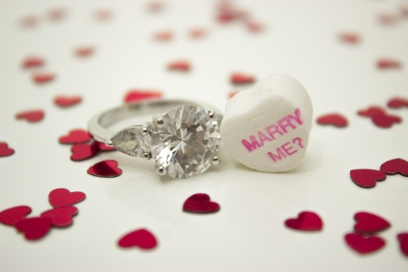 Message heart with with engagement ring and message asking  Marry Me   photo