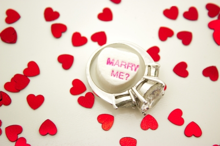 Message heart with with engagement ring and message asking  Marry Me