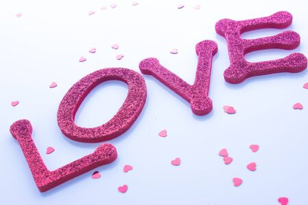 Red sparkly letters spelling out the word love photo