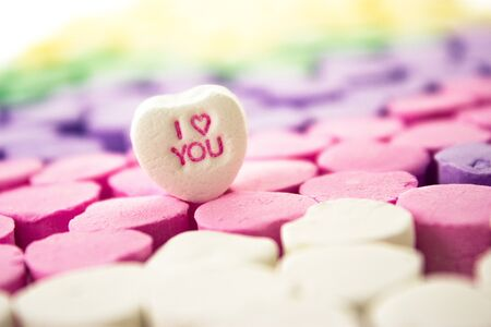 Multi-colored candy message hearts with