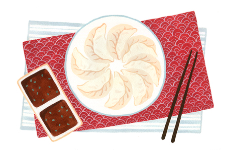 Plate of dumplings and dipping sauce