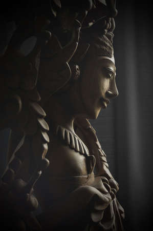 saraswati: timber carving of balinese goddess saraswati