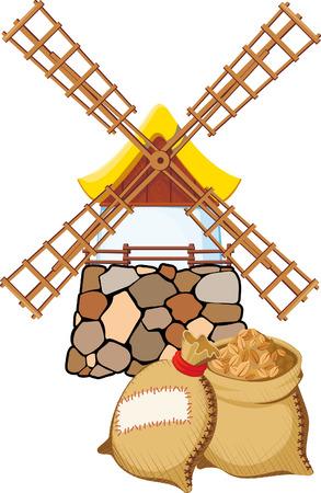 cebada: Un antiguo molino de viento y bolsas con trigo