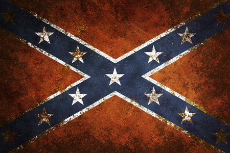 Vintage close-up of Confederate Flag. Grunge Background