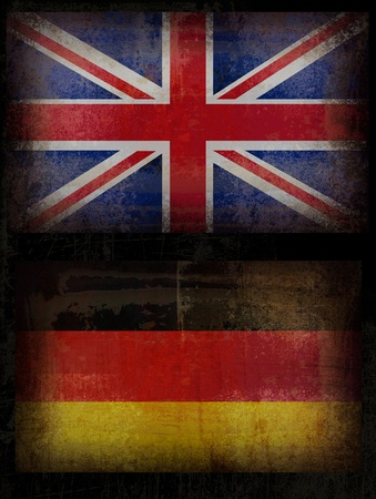 Old, Grunge British and Germany flags in black background Stock Photo - 9833629