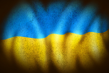 ukrainian flag: curly Ukrainian flag in dark colors and grungy stains.