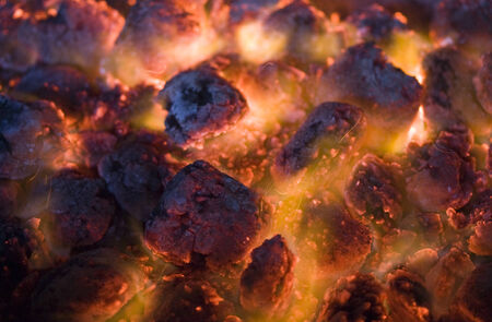 embers: burning red and black coals in the fire Stock Photo