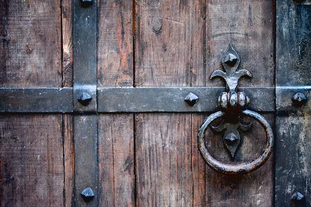 antique wrought iron door handle on oak door in the fortress photo