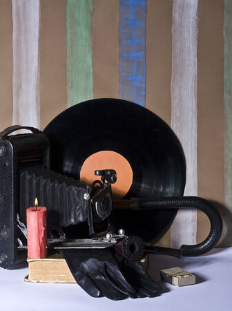 Hipster background in the background homemade wallpaper consisting of an camera, pipe, books and other photo