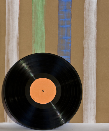 60 70: Striped wallpaper and handmade vinyl disc on their background