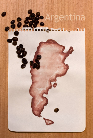 menu land: Roughly drawn on the sheet of paper with gouache map of Argentina and coffee beans on it Stock Photo