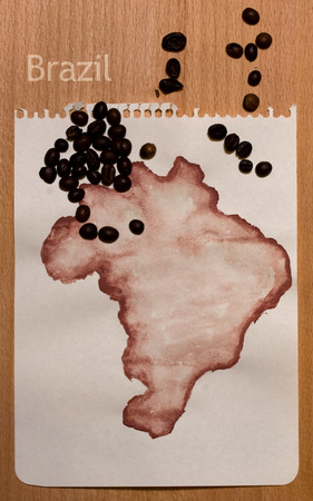 roughly: Roughly drawn on the sheet of paper with gouache map of Brazil and coffee beans on it