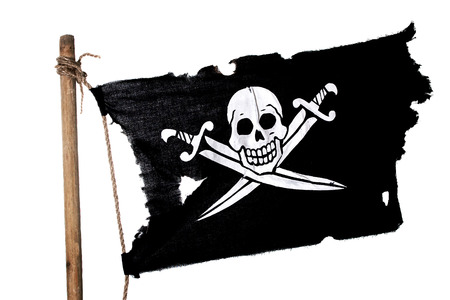 pirate flag: Waving in the wind pirate flag on the mast. Isolated on white