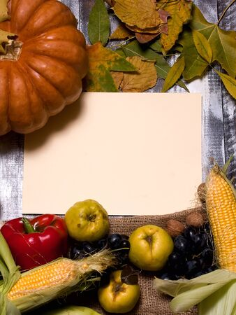 food plant: Autumn background of fruits and vegetables on the old board with empty space for text