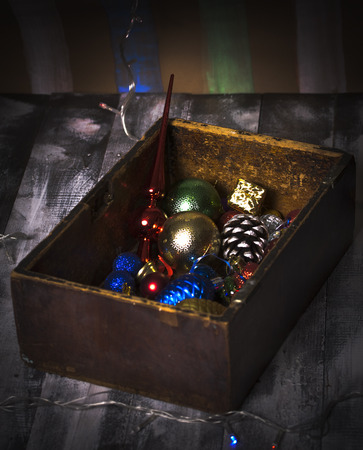 old toys: Old Wooden box with New Year old toys Stock Photo