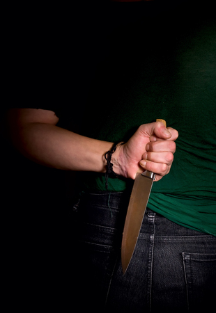 slayer: criminal who hid the hand with knife behind his back