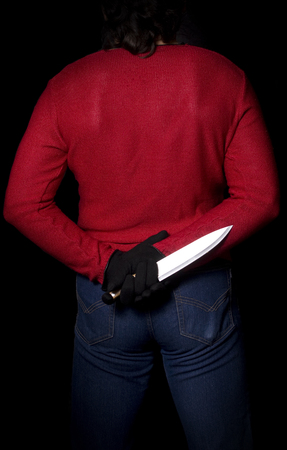 slayer: criminal who hid the knife behind his back and waits for his moment Stock Photo