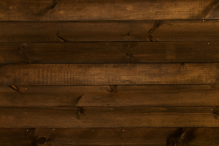 poorly: Wooden wall made of poorly processed dark old planks arranged horizontally Stock Photo