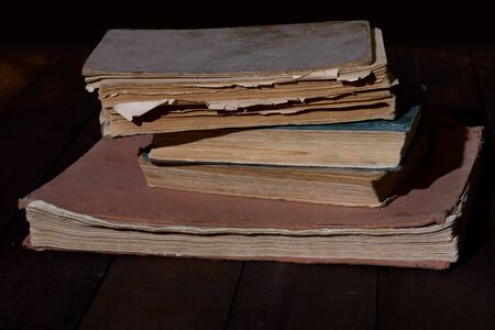 old books: few old tattered, read out books on wooden table