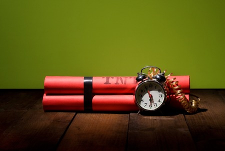 terrorism crisis: conceptual image about the alarm clock set for six oclock in the morning before the heavy working day
