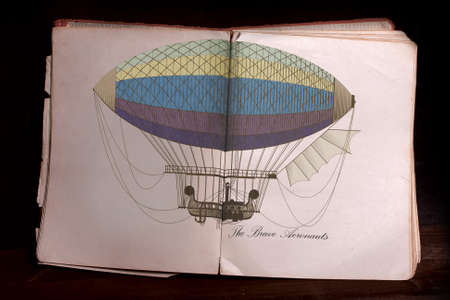 tattered: Tattered Old open book with color illustration dirigible