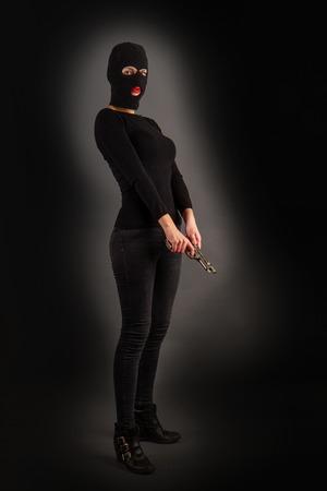 Girl in Black with Gun Banco de Imagens