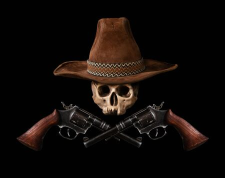 Skull in a traditional wide-brimmed cowboy hat with two revolvers on a dark background