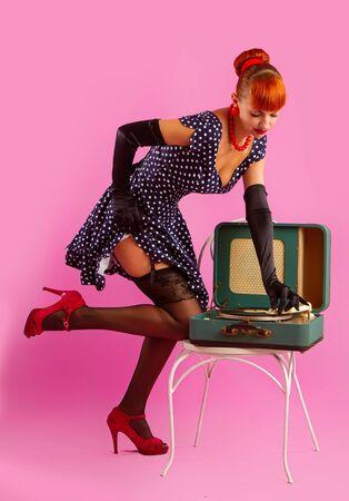 girl listening to a gramophone Reklamní fotografie