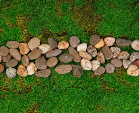 narrow path made of stones among green grass top view. Artificial Grass Used Stockfoto