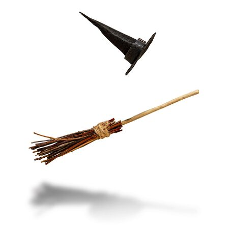 classic pointed witch hat and flying broom flying on a white background
