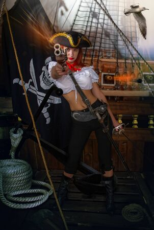 girl pirate captain in a cocked hat with a pistol and a sword under the flag Jolly Roger takes on board the enemy ship