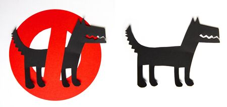 sign cut out of black and red paper prohibiting dog walking