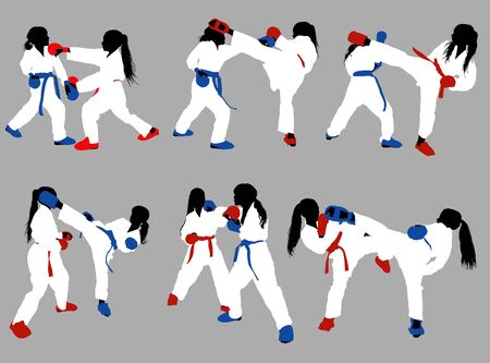 karate girls in white kimonos and red and blue belts and protective ammunition sparring against a gray background Stok Fotoğraf - 133102189