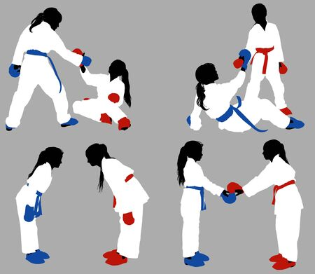 Teenage karate girls in white kimonos and blue and red outfits help each other out in training and show respect before the fight.