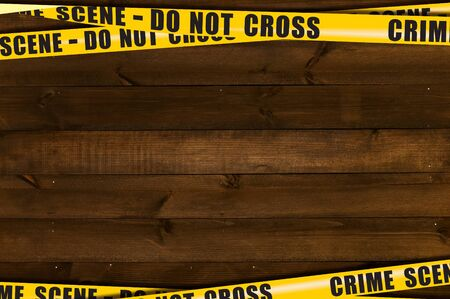 Dark wooden background with yellow poleciles prohibiting passage