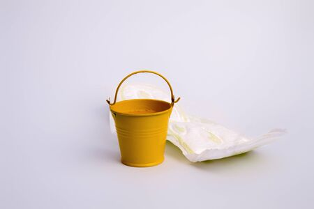 White feminine sanitary pad not neatly thrown out near an impromptu bin Banco de Imagens